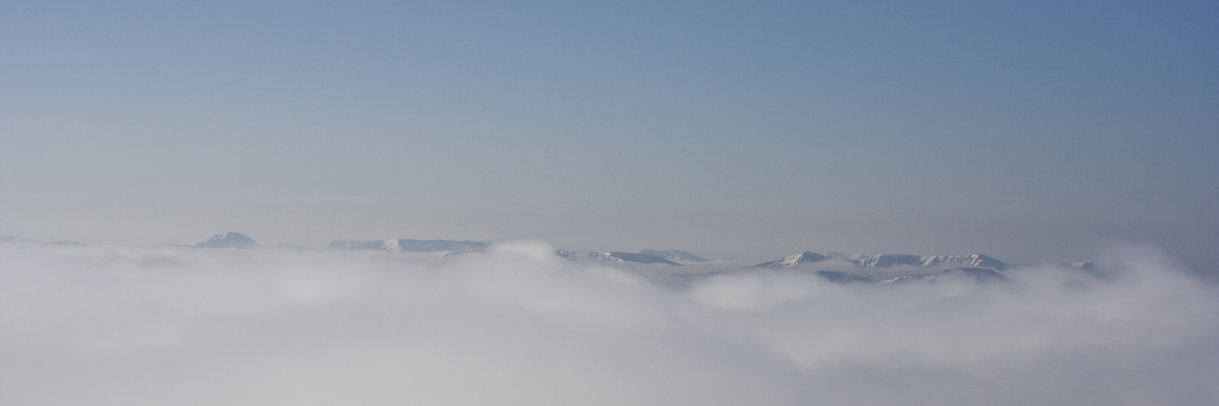 Mountain summits above an inversion